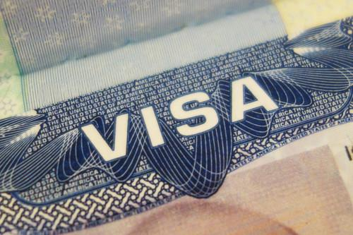 A United States visa is seen inside a passport, in this image taken on June 17, 2015.