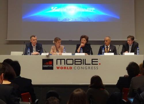 Neelie Kroes (center), Hossein Moiin (second from right) and Marcus Weldon (right) discussing the 5G Infrastructure PPP at Mobile World Congress