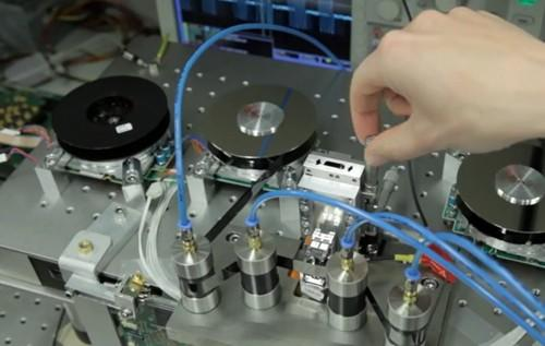 IBM researchers test their new tape prototype.