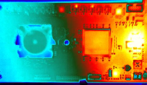 "The IBM ""TrueNorth"" chip is designed for low power consumption, shown in this thermal image that shows the cool TrueNorth chip alongside hot FPGA chips that are feeding data to  TrueNorth."
