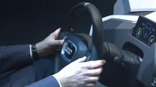 Simultaneously pressing two buttons, one to either side of the steering wheel, will engage autonomous driving mode in Volkswagen's prototype of a future car interface, James 2025, shown at the opening ceremony of Cebit 2014.