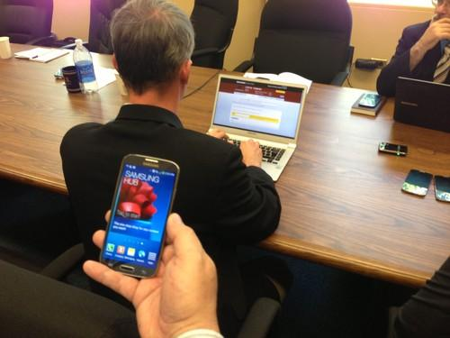 Law enforcement officials try and crack anti-theft security systems on Samsung phones during an event at the San Francisco District Attorney's office on July 18, 2013.