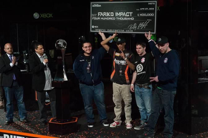 Treyarch studio head, Mark Lamia, and game design director, David Vonderhaar, present team Fariko Impact with a check for $400,000 for winning the Call of Duty Championship