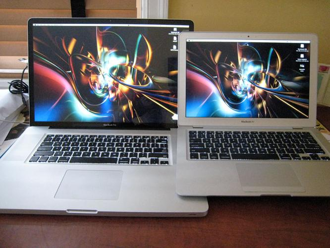 The biggest of Apple's laptop line compared to the smallest, a second-generation MacBook Air (right).