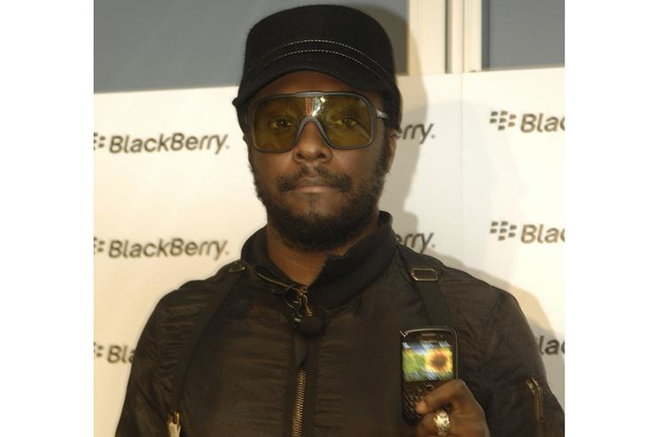 Black Eyed Peas star will.i.am poses with the latest BlackBerry smartphone, the Curve 8520