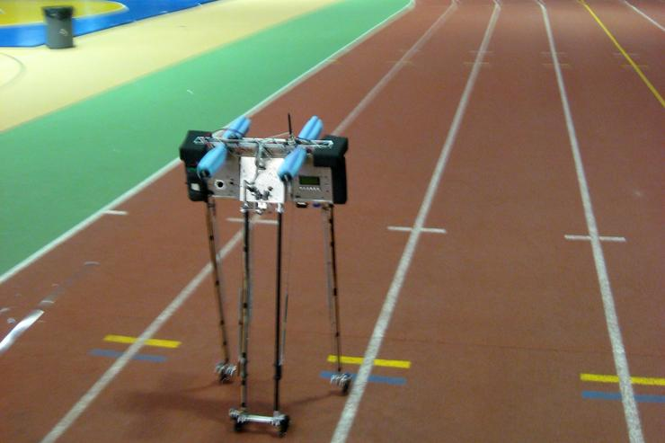 It took 65,185 steps for Cornell's 4-legged bipedal robot to walk 108.5 laps on Barton Hall's 1/8-mile indoor track, setting a new world record for non-stop distance walked by an untethered legged robot - more than a half a marathon. Ranger took about 20,000 steps, over three miles, for each penny worth of electricity it used. Ranger was steered with a model-plane remote control. Commands from the remote control twist the inner pair of legs. The walking was entirely controlled by the 6 onboard microprocessors.