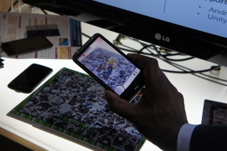 Qualcomm's augmented reality can add virtual content onto a printed landscape.