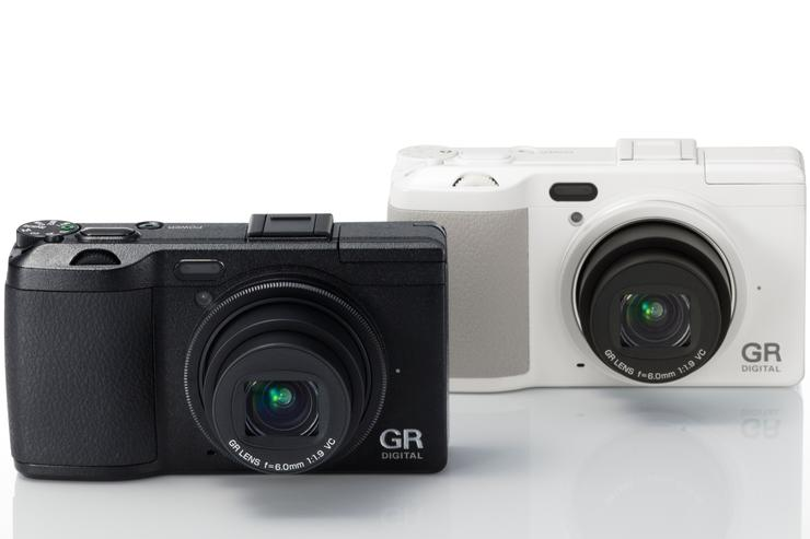 The new Ricoh GR Digital IV camera, in black and limited edition white.