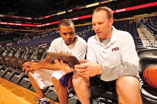 Phoenix Suns Assistant Coach Noel Gillespie confers with point guard Sebastian Telfair using a Galaxy Tab 10.1 tablet.