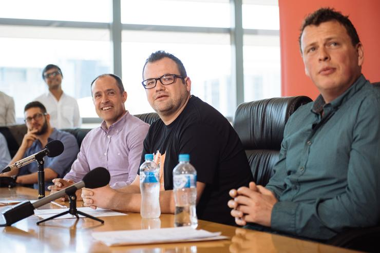 Founder Ruslan Kogan (centre) announcing the return of Kogan Mobile