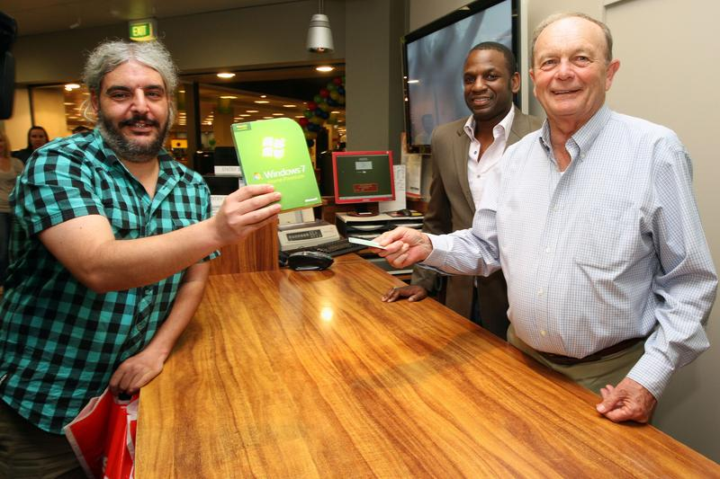 Gerry Harvey sells first copy of Windows 7