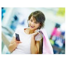 Girl happily using her mobile phone