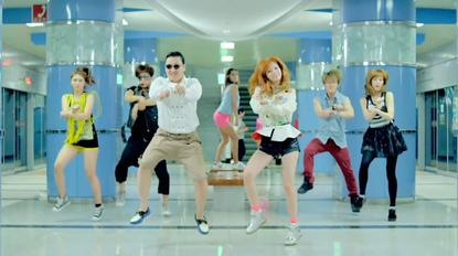 Buy me a pony: South Korean pop artist PSY (third from left) in a scene from his cult music video, Gangdam Style