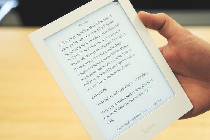 The Kobo Aura HD showing a page of Moby Dick, with the ComfortLight front-light turned on.