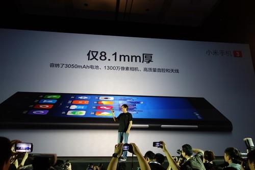 Xiaomi CEO Lei Jun showing off his company's new phone