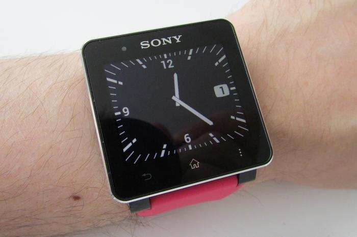 White-on-black analogue watch face, showing date, with backlight on maximum.