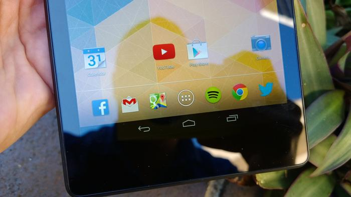 The Nexus 7's full HD display is outstanding, but the large bezels on the top and bottom are a downside.