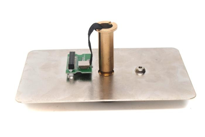 The mounting plate that plugs in to the main unit and the mounting pole through which the camera's cable needs to be passed through and connected to the circuit board.